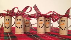 Set of 6 adorable wine cork snowman ornaments. These can be used to decorate your tree or given as a gift. Wine lovers will go crazy over this