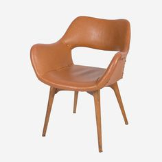 This is an iconic design by Featherston in 1953.These chairs are highly collectable, and becoming harder and harder to come across.Stylish and comfortable, this is a great dining chair, office chair, or fantastic as a statement piece!This chair is in great structural condition, with original fabric. There is one button top missing on the seat, which is a common occurrence with these type of chairs. It doesn't affect the overall appearance of the chair, however.Delive...
