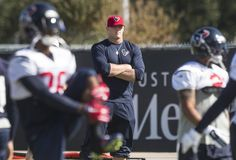 Houston Texans defensive end J.J. Watt watches his team warm up from the sidelines during practice at the Methodist Training Center on Wednesday, Oct. 28, 2015, in Houston. ( Brett Coomer / Houston Chronicle )