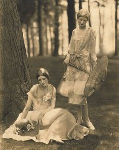lovely dresses on two 1920s ladies. love the parasol