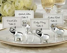 Lucky in Love Lucky Elephant Place Card Holder. Charming, resin silver finish elephant with raised trunk containing small slit for place card or photo. Set of Wedding Places, Wedding Place Cards, On Your Wedding Day, Wedding Stuff, Wedding Season, Wedding Supplies, Party Supplies, Vintage Elephant, Baby Elephant