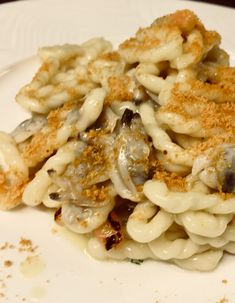 Lorighittas pasta with wild clams and grey mullet bottarga