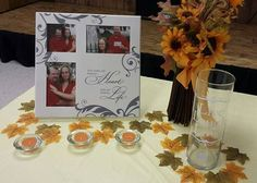 Simple decor for a wedding gift table~ Picture frame, flowers, candles Simple Wedding On A Budget, Simple Weddings, Budget Wedding, Wedding Ideas, Gift Table Wedding, Wedding Gifts, Picture Frames, Alcoholic Drinks, Candles