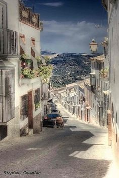 """Spain.  Olvera, Andalusia, ES.     """"Street in Olvera, Spain leading down from the castle.""""    Photograph by Light+Shade via Flickr.  Photograph taken on July 2, 2010."""