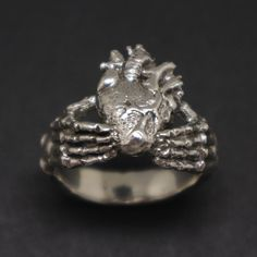 Buy Skull Hand Holding Heart Claddagh Ring from Handmado. Handmade in 925 Sterling Silver with High Quality Craftsmanship. Shop with confidence. Skull Jewelry, Fashion Jewelry Necklaces, Gothic Jewelry, Heart Jewelry, Heart Ring, Jewelery, Jewelry Rings, Fashion Jewellery, Skull Rings