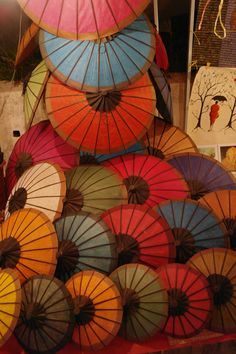 many colorful umbrellas make one happy . laos