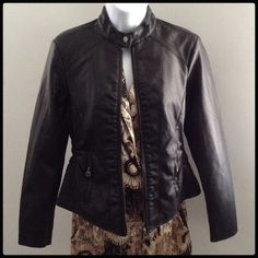 Black faux leather jacket Sleek black faux leather jacket with pockets. Sides gather. Zips up and buttons at top. Shell 100% polyurethane. Shell backing 50% viscose 50% polyester. Lining 100% polyester. New. Never been worn. Baccini Jackets & Coats