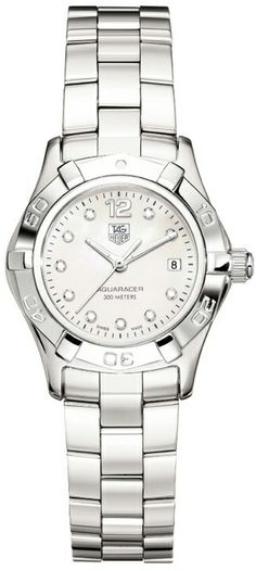 WAF1415.BA0824  NEW TAG HEUER AQUARACER 2000 LADIES WATCH  IN STOCK      - FREE Overnight Shipping   Lowest Price Guaranteed- NO SALES TAX (Outside California)- WITH MANUFACTURER SERIAL NUMBERS - White Mother of Pearl Diamond Dial- 10 Full Cut Diamonds Set on Dial (.07ct) - Top Wesselton (F-G) Color Grade - Certified VS Superior Diamond Clarity - Battery Operated Quartz Movement- 3 Year Warranty- Guaranteed Authentic- Certificate of Authenticity- Scratch Resistant Sapphire Crystal- Polished…