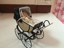12 scale miniature pram with baby