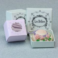 Soft pink and green printable French bakery boxes hold dollhouse cakes and pastries.