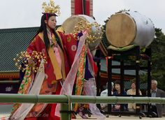 A woman dressed in junihitoe dancing at the Heian Shrine .