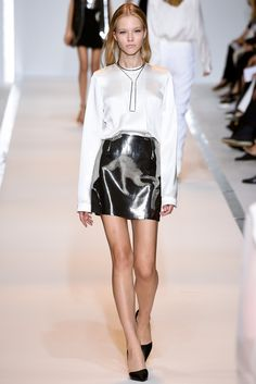Mugler   Spring 2015 Ready-to-Wear   15 White long sleeve top and silver striped mini skirt
