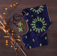 Bullion knots with antique zari designs enhance the beauty of this attractively coloured blouse. 31 August 2019 Bullion knots with antique zari designs enhance the beauty of this attractively coloured blouse.