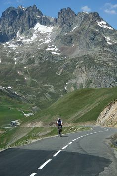 Cycling in Col du Glandon (el. 1924 m.), Dauphiné Alps in Savoie, France…