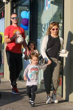 Family day:Sarah Michelle Gellar and Freddie Prinze Jr took their childrenCharlotte and Rocky shopping in Santa Monica, California, on Saturday