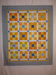 Yellow and Blue Nine-Patch quilt top