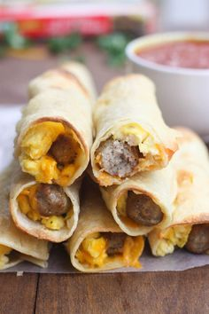 Scrambled eggs, cheese and sausage links rolled and baked inside a corn tortilla. These Egg and Sausage Breakfast Taquitos are simple and delicious! | Tastes Better From Scratch