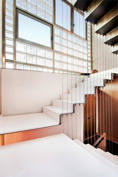 Folded plate staircase with vertical rod suspension.  Vivienda unifamiliar entre medianeras, constructed 2010, Barcelona, Spain. YES I love this style of staircase