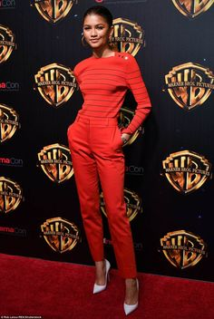 Lady in red: Zendaya, 21, epitomized chic in a red trousers and sweater combo...