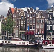 Amsterdam (Netherlands) aligned with canals   and lined with houseboats