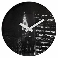 """Showcasing an au courant cityscape in black and white, this cosmopolitan wall clock brings a modern touch to your living room or home office.    Product: Wall clockConstruction Material: PlasticColor: Black and whiteFeatures: High torque movementsAccommodates: (1) AA battery - not includedDimensions: 15.3"""" Diameter x 1.5"""" D"""