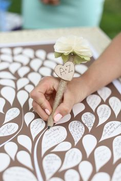 Adorable petal print guestbook! Photo by Aaron Snow Photography. #wedding