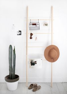 Cute DIY ladder - you can use it for towels, clothes, postcards, or whatever you feel like hanging on it!