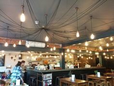 Beautiful ceiling decor with lamps. Alice pub in Queens park London.