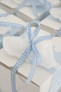 Love this ... fill these little boxes with blue candy (like blue and white m&m's) and there's a sweet party favor!