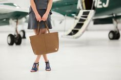 Let Bottega Be a Part of Your Next Adventure! Photo: @tracymoorephoto      #MyBottega #shopsatshilohcrossing #travel #ootd #ootn #pack #planes #jets #vacation #worktrips #fashion #friends #photoshoot #hapoy #happiness #worlds #sightseeing #seetheworld #chic #classic #spring #tote #purse #dress #shoes #blue #heels #Thursday