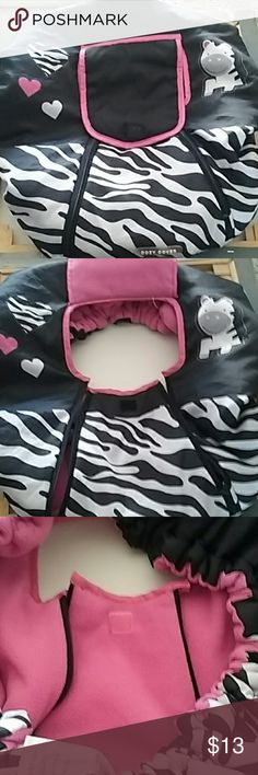 Cozy Cover Cover for baby carrier. Cute zebra print and pink. Just slip it right over carrier, stays open with velcro fastner. Dual zippers for easy access to baby.  Genlty used but in great condition. Helps protect baby from the elements. Accessories