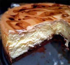 Cheesecake w/ a Dark Chocolate Tiramisu Crust, a Coffee Amaretto Soft Shell, and a Creamy Amaretto Filling