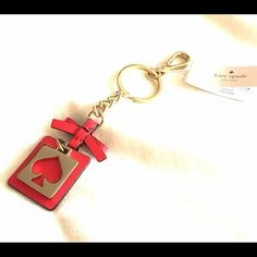 Kate Spade keychain Brand new Kate Spade keychain. Gold hole punch on geranium leather. You could clip it to a bag as well. kate spade Accessories Key & Card Holders