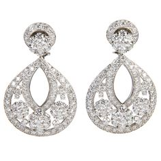 Van Cleef & Arpels Diamond Platinum Large Snowflake Earrings | From a unique collection of vintage chandelier earrings at https://www.1stdibs.com/jewelry/earrings/chandelier-earrings/