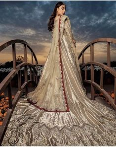Lustrous gold fabric embedded with fine sequins, coruscating motifs and glinting pearls, Everthine's dreamy creation has a majestic aura along with breathtaking details. Pakistani Party Wear Dresses, Shadi Dresses, Dresses Short, Formal Dresses, Wedding Dresses, Moroccan Wedding, Moroccan Dress, Designs For Dresses, Indian Designer Wear