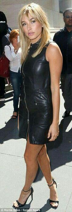 Blonde in black leather dress