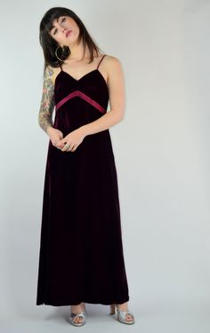 Gorgeous 1970s Joseph Magnin maxi! Made in a deep red velvet material. Thin shoulder straps, V neckline. Empire waistline with decorative satin material. Center back zipper. Added strings to tie into bow on back. Maxi length with an A-line skirt. Bodice is lined, the rest is not. ♥  Size: Small Tag: 8 Brand: Joseph Magnin Very Good Vintage Condition: Some minor crushing to the velvet, Shoulder straps have been adjusted, and are hand sewn in the interior, one small mend on shoulder strap.♥…