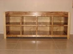 This is a bench with compartments. This would be nice for my house to put shoes in.