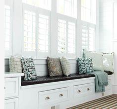 window seat with white shuttered windows. http://mulberryinteriordesign.ca
