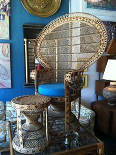This 1970s peacock chair was handcrafted in the Philippines. Chair comes with a matching stool that could be used as an ottoman, a side table, or additional seating. The intricately woven arm design and comfortable cushion make this chair a dream come true.