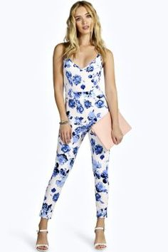 c61bf09bb157 Tired of floral dresses  Try on a floral jumpsuit this summer to add a  little edginess.