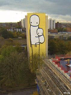 'Big Mother,' the 125 ft high (38.2 metre) mural painted on a condemned council owned tower block in Acton, West London, is the tallest street artwork in the UK - Stik November 2014