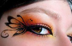 Orange and black butterfly eye make-up