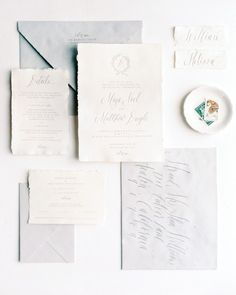 An Intimate Garden Wedding at a Michigan Bed & Breakfast | Martha Stewart Weddings - The bride created her own heirloom stationery suite with a custom typeface and wax seal. Details were written in romantic calligraphy and a stately font on feathery handmade paper. #weddingideas #weddinginvitations #weddingcalligraphy #calligraphy