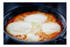 Shakshuka  (uses 8 eggs!)    4 cloves garlic  1 onion in  2 Tbsp olive oil + more for drizzling  1 cup crushed tomatoes  2 fresh tomatoes chopped  1 tsp harissa  8 eggs  Coarse salt + pepper  + a nice warm bread