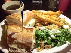 Westville, Hudson Square, NYC   @WestvilleNYC    French dip sandwich  $17) had thin slices of beef and melted Swiss cheese on crispy baguette with au jus for dipping, accompanied by parmesan fries and an arugula, blue cheese and walnut salad