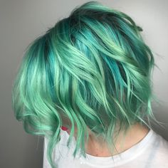 Another alternative to cotton candy-esque blues and greens is sea glass, which is perfect for those who want a bold but multidimensional blue shade. More.com reports that this breathtaking hue was created by a color company called Pulp Riot, which aims to re-create the gorgeous tones found in actual sea glass or discarded jewelry on the ocean floor.To create the look, McGowan Hansen recommends combining different highlights of blue and green throughout the hair, making it best suited for…