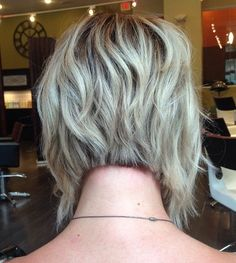 Inverted angled layered bob....this is what I was surprised with in my extreme makeover but with better color. Never in a million years would I have picked it but my hairstlyist knows me better than me. :) I love it!!!