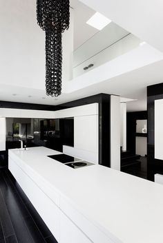 Minimal kitchen area inside the Casa Murano by Architects LEE+MIR _