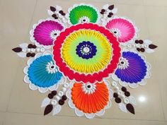 Here is a simple freehand rangoli design for Diwali. It is based on one of my original rangoli designs and I have tried to do some innovation with the placem. Simple Rangoli Designs Images, Rangoli Designs Flower, Colorful Rangoli Designs, Rangoli Designs Diwali, Diwali Rangoli, Beautiful Rangoli Designs, Easy Rangoli, Rangoli Photos, Rangoli Ideas